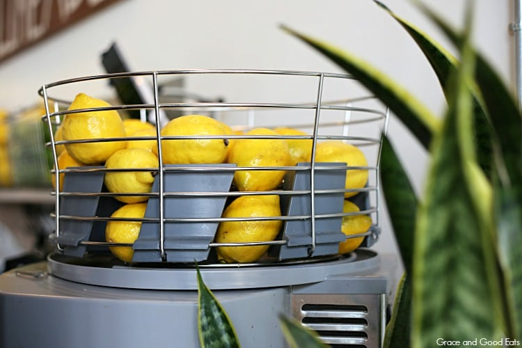 lemons on top of a juicer