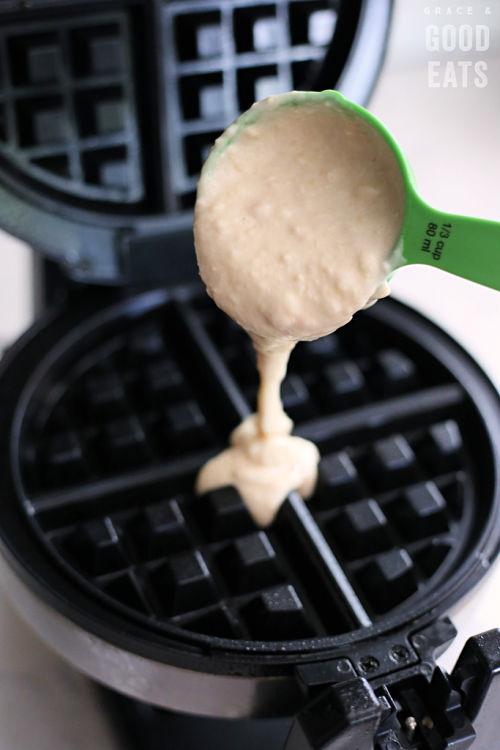 pouring waffle batter into a waffle maker
