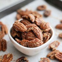 small white bowl of pecans