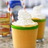 pumpkin smoothie in a glass with whipped cream