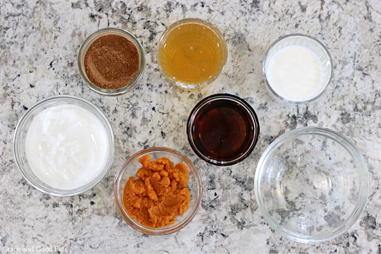 pumpkin smoothie ingredients in glass bowls