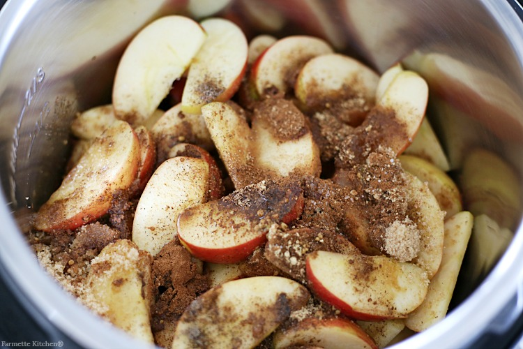 apple slices in a pressure cooker with spices