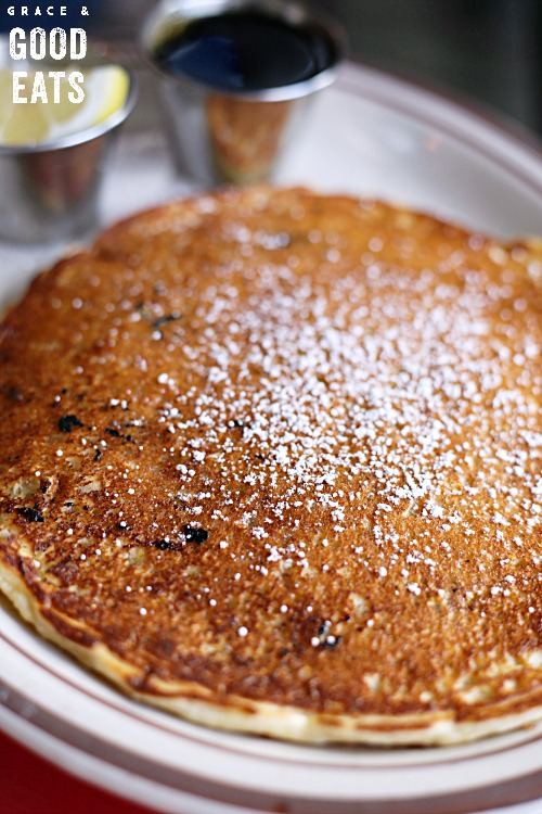 blueberry pancakes dusted with powdered sugar