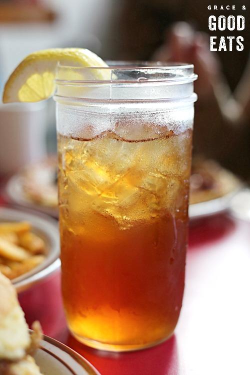 glass of sweet tea in a mason jar with lemon