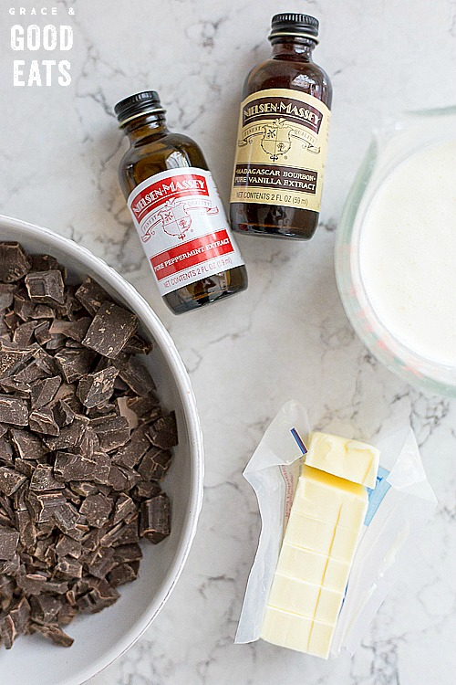 chopped chocolate next to heavy cream and cubed butter