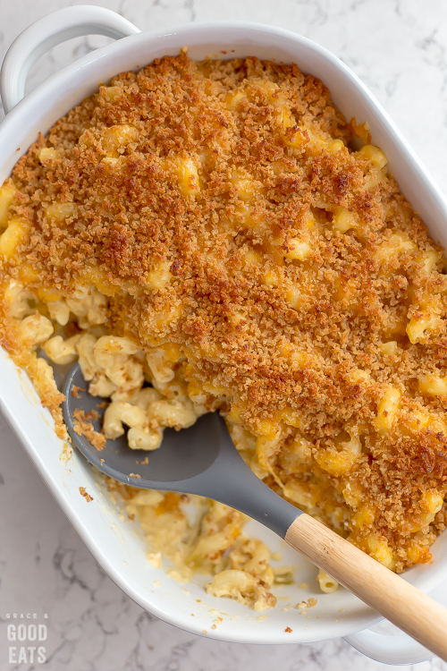 casserole dish of mac and cheese with a big portion scooped out