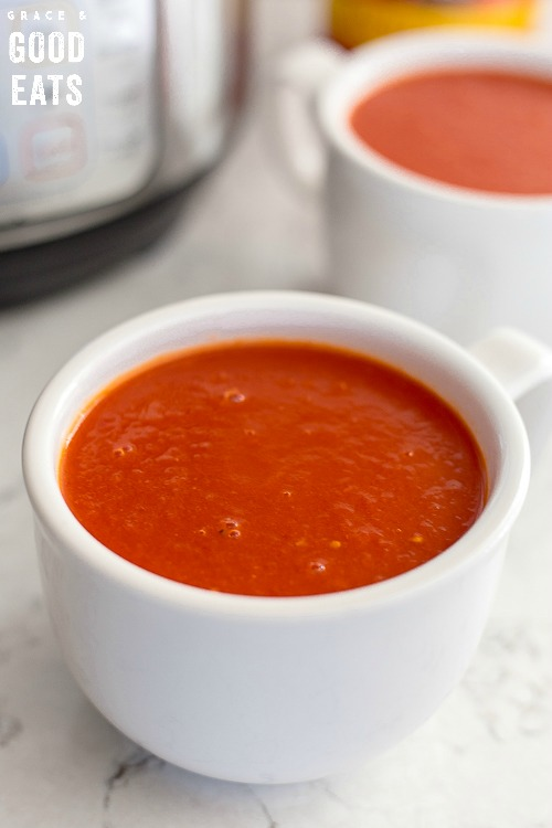 two bowls of tomato soup next to an Instant Pot pressure cooker