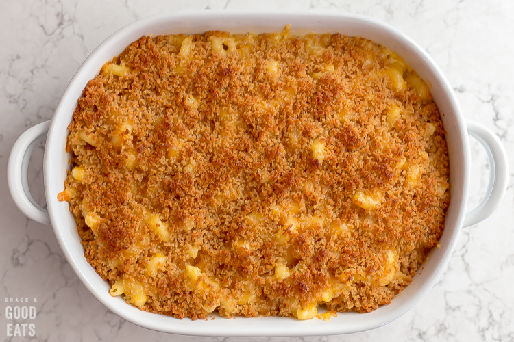 mac and cheese topped with Panko in a casserole dish