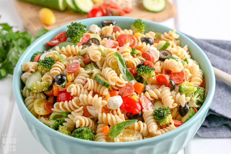 ceramic blue bowl filled with pasta salad