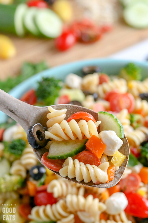 wooden spoon full of pasta salad