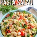 Italian Pasta Salad made with crunchy veggies, fresh mozzarella, tender rotini noodles, and a simple dressing. This easy pasta salad recipe is deliciously flavorful as is, but also totally flexible- omit the meat, add in your favorite veggies, or sub in different cheeses to your liking.