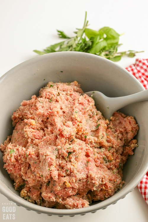 raw meatball mixture in a mixing bowl
