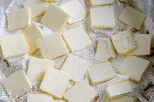 pats of butter atop a flour mixture