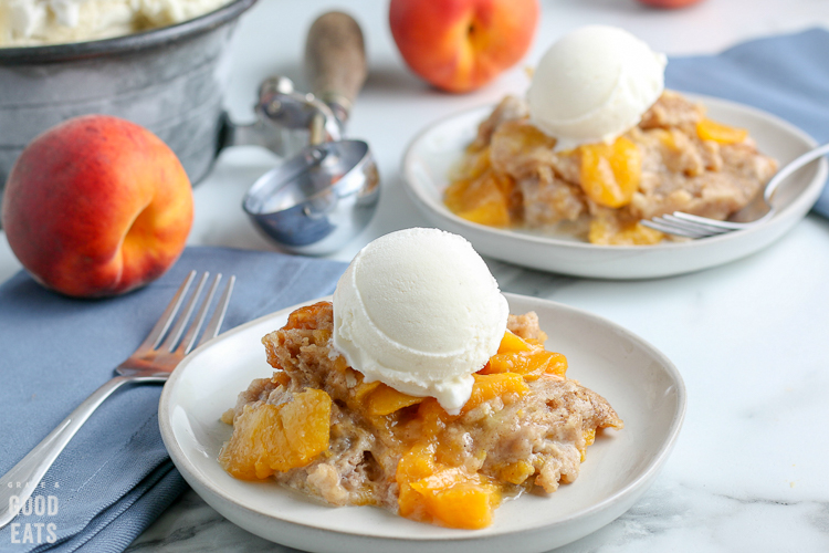 white plate with peach cobbler