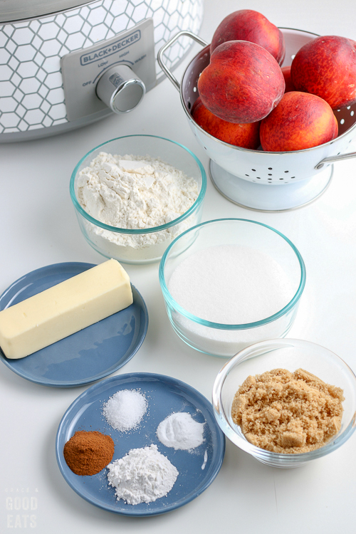 butter, flour, sugar, spices, peaches in separate bowls