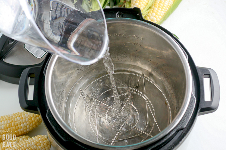 pouring water in a pressure cooker