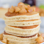 stack of pancakes topped with apple compote