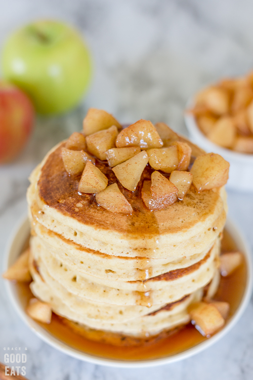 stack of pancakes with apple compote and syrup