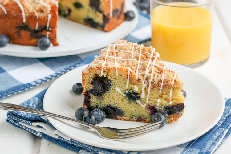 close up of a slice of blueberry coffee cake