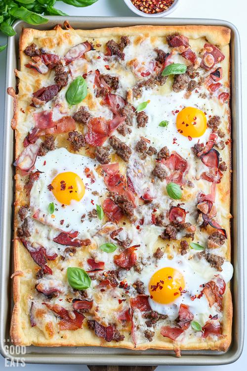 breakfast pizza on a baking sheet