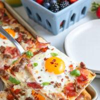 slice of breakfast pizza on a spatula