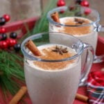 glass mug with homemade eggnog and a cinnamon stick