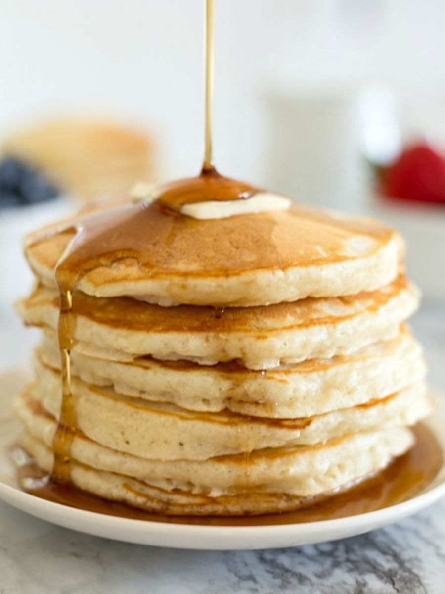 homemade pancakes on a plate with syrup