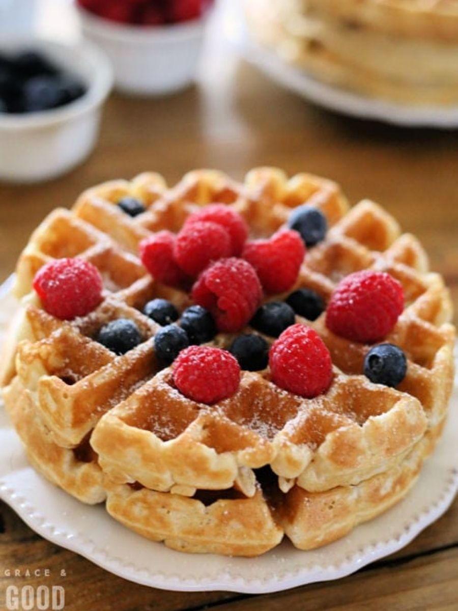 waffles on a plate topped with berries