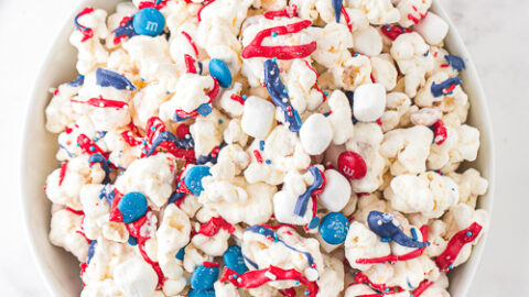 patriotic popcorn with red, white, and blue chocolate candies in a bowl